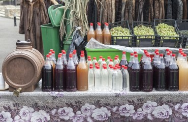 Bottles of stum exposed for sale at an agricultural fair