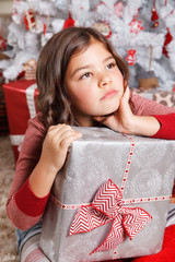 Portrait of a sad little girl at Christmas