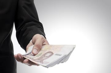 Thai money in hand, Investment concept