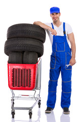 young mechanic shopping tires