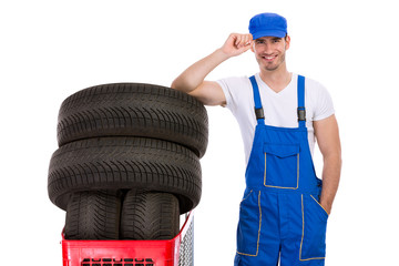 Smiling mechanic buy tires