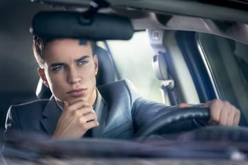 elegance man driving his car