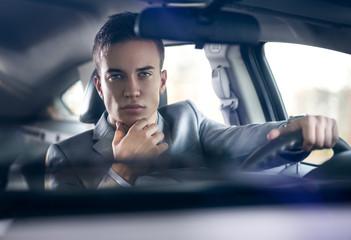 elegance stylish men in car