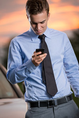 young businessman looking ta smart   phone