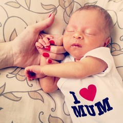 Beautiful baby mother's day hand love care dream