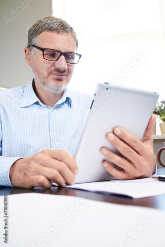 canvas print picture businessman with digital tablet