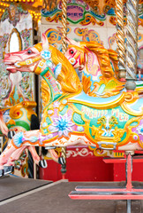 Beautiful decorated horse on a merry-go-round