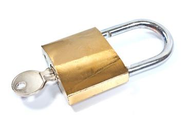 Padlock with key isolated on white