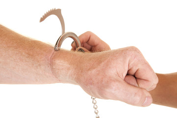 handcuff coming off of an arm
