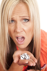 woman face close hand full of dice shocked look