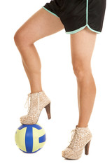 woman legs heels step on volleyball