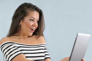 attractive cute happy young emotional woman using tablet device