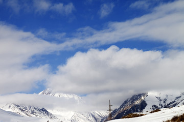 Ski slope and blue sky with clouds