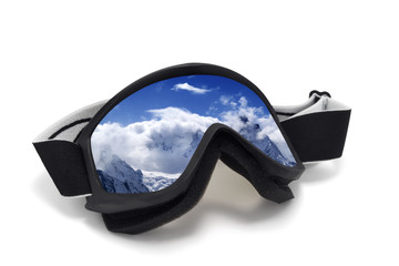 Ski goggles with reflection of snowy mountains