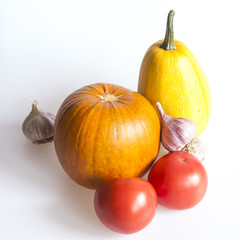 Orange pumpkin, tomato, garlic for salad
