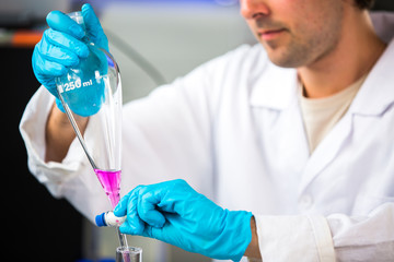 Young male researcher carrying out scientific research in a lab