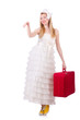 Woman in wedding dress with suitcase