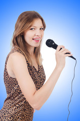 Woman singer with microphone on white