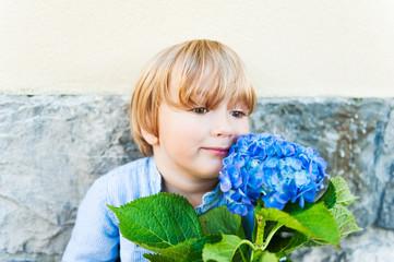 Close up portrait of a cute blond toddler boy