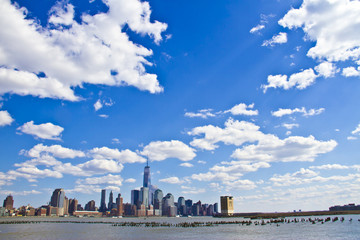 lower Manhattan in front of beautiful sky