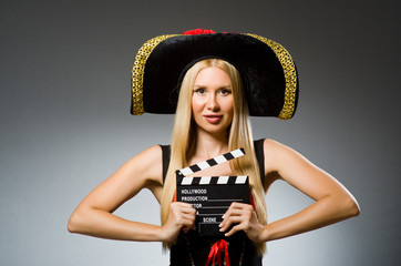Woman in pirate costume with movie board