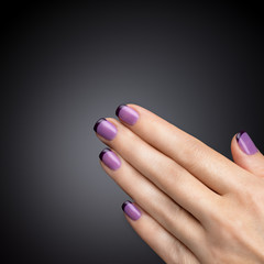 Beautiful manicure, polish is a violet color.