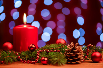 Red Christmas candle with pine cone decoration
