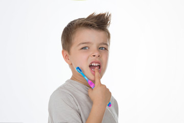 little kid with toothbrush