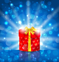 Round gift box on light background with glow