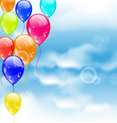 Flying colourful balloons in blue sky