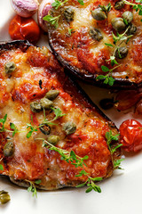 Grilled eggplant stuffed tomatoes, cheese and herbs