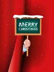 Weihnachtsmann hält Schild Merry Christmas hinter Vorhang