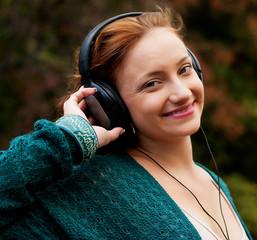 Enjoying music in autumn park