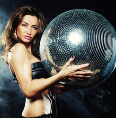 girl in smoke with disco ball