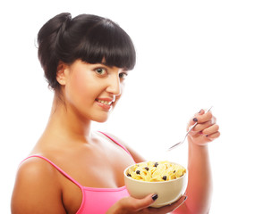 smiling woman eating muesli