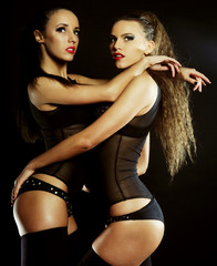 Fashion shoot of two young sexy striptease dancer