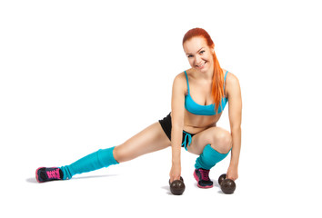 young red-haired girl doing exercises