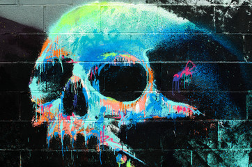 Graffiti of a human skull on a wall