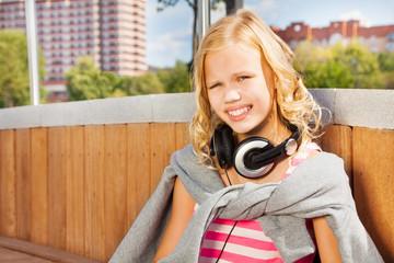 Close view of girl wearing headphones, sweatshirt