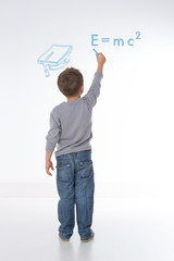 child writes maths formula