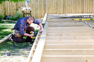 Carpenter drilling on deck