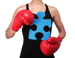 bust of a woman boxer holding a puzzle piece