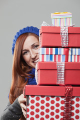 Smiling Woman Holding Stack of Presents