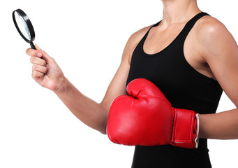 woman boxer with a magnifying glass