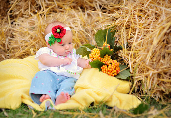 baby girl on hay in the Ukrainian style
