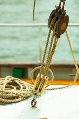 Yachting. Block with rope. Detail of a sailing boat