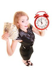 Woman holding polish money banknote and alarm clock.