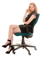 Business office concept - businesswoman sitting on a chair