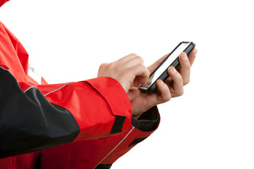 Man in wind jacket using mobile phone sending sms