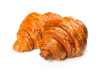 Fresh and tasty croissant over white